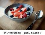 cream and berries dessert in...   Shutterstock . vector #1057533557