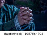 close up of man hands wrapped... | Shutterstock . vector #1057564703