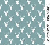 seamless winter pattern with... | Shutterstock .eps vector #1057633043