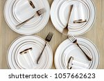 disposable tableware for four... | Shutterstock . vector #1057662623