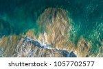 aerial view of waves in ocean... | Shutterstock . vector #1057702577