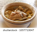 daylily soup with pork in a... | Shutterstock . vector #1057713047