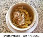 daylily soup with pork in a... | Shutterstock . vector #1057713053