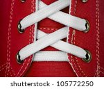 White lace on red sneakers close up - stock photo