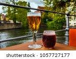 two glasses of belgian beer... | Shutterstock . vector #1057727177