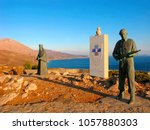 Small photo of Crete, Greece - October 5, 2017: War Memorial near the monastery of Preveli against the German occupation in WWII. Statues of Armed abbot of monastery Agathanggelos Laggouvardos and of Allied Soldier.