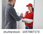 young man receiving order from...   Shutterstock . vector #1057887173