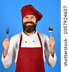 chef holds cutlery.... | Shutterstock . vector #1057924607