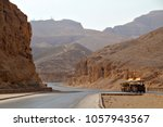 a vehicle transports tourists... | Shutterstock . vector #1057943567