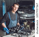 master collects a rebuilt motor ... | Shutterstock . vector #1057957367