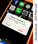 deleting facebook app on... | Shutterstock . vector #1057961123