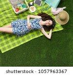 young smiling woman relaxing...   Shutterstock . vector #1057963367