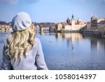 lady looking at charles bridge  ... | Shutterstock . vector #1058014397