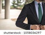 man in custom tailored suit... | Shutterstock . vector #1058036297