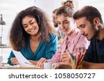 in college. a multi ethnic... | Shutterstock . vector #1058050727