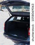 the trunk of a car. open trunk... | Shutterstock . vector #1058069063