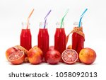 glasses of fresh pressed blood... | Shutterstock . vector #1058092013