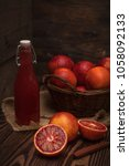 blood orange fruit in a wicker... | Shutterstock . vector #1058092133