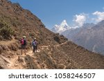 Small photo of tourists go to Everest against background of Ama Dablam, Himalayas, Nepal