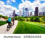 riding bikes on paved trail in... | Shutterstock . vector #1058261033