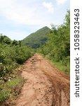 poor condition rural road in... | Shutterstock . vector #1058323463