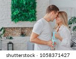 the guy with the girl hugs and... | Shutterstock . vector #1058371427