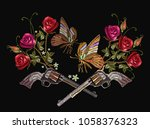 embroidery crossed guns ... | Shutterstock .eps vector #1058376323