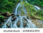 waterfall of putri waterfall in ... | Shutterstock . vector #1058402393
