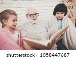grandfather  grandson and...   Shutterstock . vector #1058447687