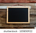 Blackboard on the wood wall. - stock photo