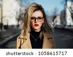 fashion young girl in glasses.... | Shutterstock . vector #1058615717