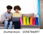 young couple shopping online on ... | Shutterstock . vector #1058786897