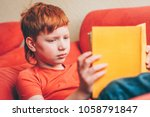 cute red haired boy with... | Shutterstock . vector #1058791847