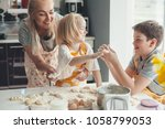 beautiful blond mom teaching... | Shutterstock . vector #1058799053