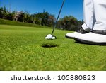Golfer On The Putting Green ...