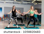 Small photo of group aerobics with a coach in the gym