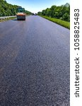 Small photo of Road roller rolls freshly laid asphalt