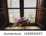 bouquet of red  white flowers... | Shutterstock . vector #1058930597