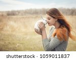 the girl with the rabbit.happy... | Shutterstock . vector #1059011837