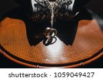 wedding rings of bride and... | Shutterstock . vector #1059049427