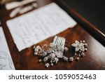 bride's jewelry lie on a wooden ... | Shutterstock . vector #1059052463