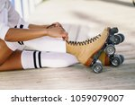 close up of black girl sitting... | Shutterstock . vector #1059079007