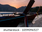 longtail boat at sunset against ... | Shutterstock . vector #1059096527