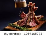 rack of lamb with rosemary on... | Shutterstock . vector #1059165773