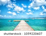 pier in turquoise sea and blue... | Shutterstock . vector #1059220607