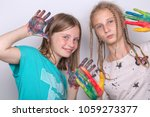 portrait two young girls and... | Shutterstock . vector #1059273377