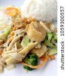 stir fry yellow tofu and... | Shutterstock . vector #1059300557