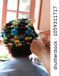 perm in the beauty salon  close ... | Shutterstock . vector #1059311717