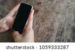 hands using smart phone on... | Shutterstock . vector #1059333287