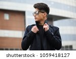 asian young adult man on street ...   Shutterstock . vector #1059418127